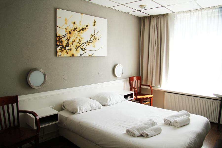 Grand hotel central rotterdam familiehotel in het for Kamer rotterdam